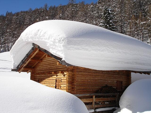 Snow Accumulated on Cabin Roof