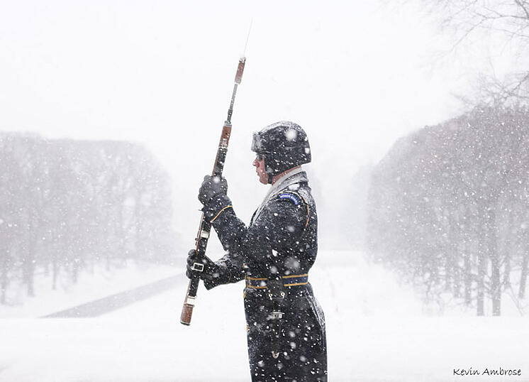 Soldier Guards the Tomb of the Unknowns in Snow (credit: Kevin Ambrose)