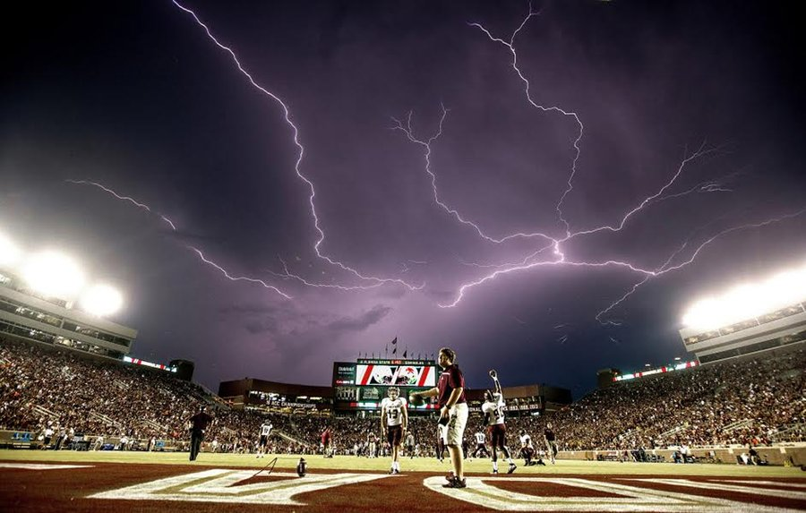 Lightning at Football Game- Mark Wallheiser/AP